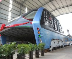 A model of an innovative street-straddling bus called Transit Elevated Bus is seen after a test run in Qinhuangdao, Hebei Province, China, August 3, 2016. The test bus currently consists of one segment, and is capable of carrying 300 people, according to local media. REUTERS/Stringer ATTENTION EDITORS - THIS IMAGE WAS PROVIDED BY A THIRD PARTY. EDITORIAL USE ONLY. CHINA OUT. NO COMMERCIAL OR EDITORIAL SALES IN CHINA.   - RTSKT17